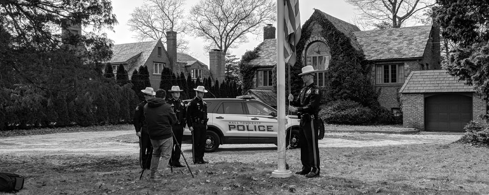 Wall Township Police Officers Salute Harry Rockafeller's American Flag
